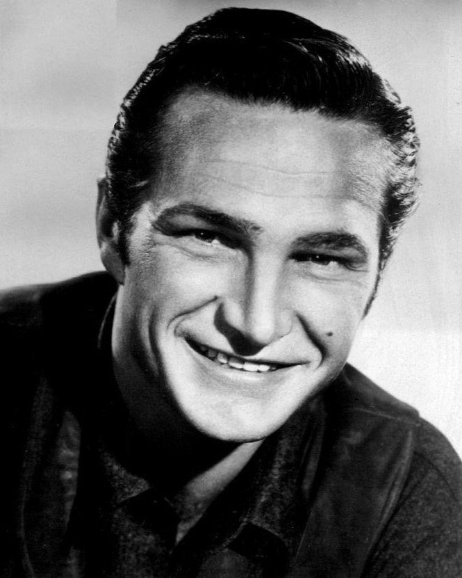 Publicity photo of Eric Fleming, circa 1960s. | Photo: Wikimedia Commons