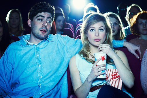 A couple pictured enjoying a movie at the cinema | Photo: Getty Images