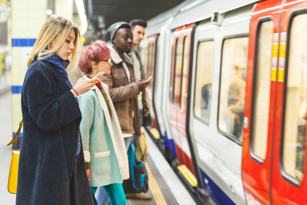 A photo of people waiting to board a train   Photo: Shutterstock