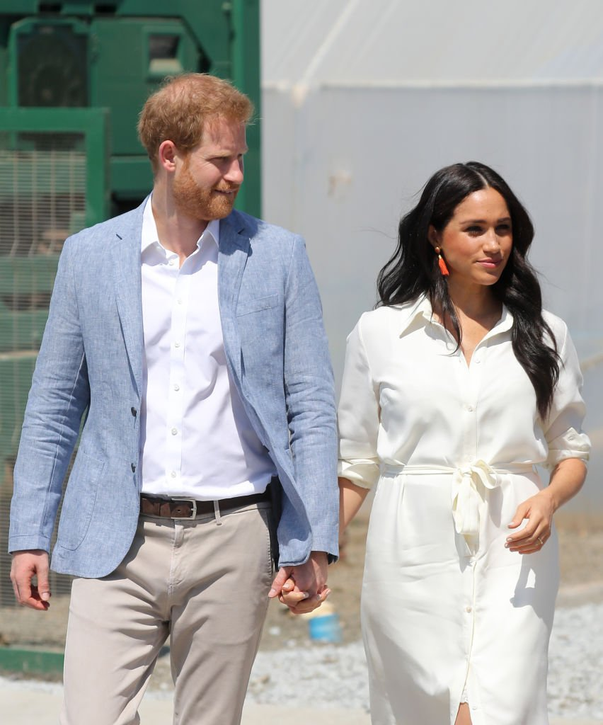 Prince Harry and Meghan visit a township to learn about Youth Employment Services.   Source: Getty Images