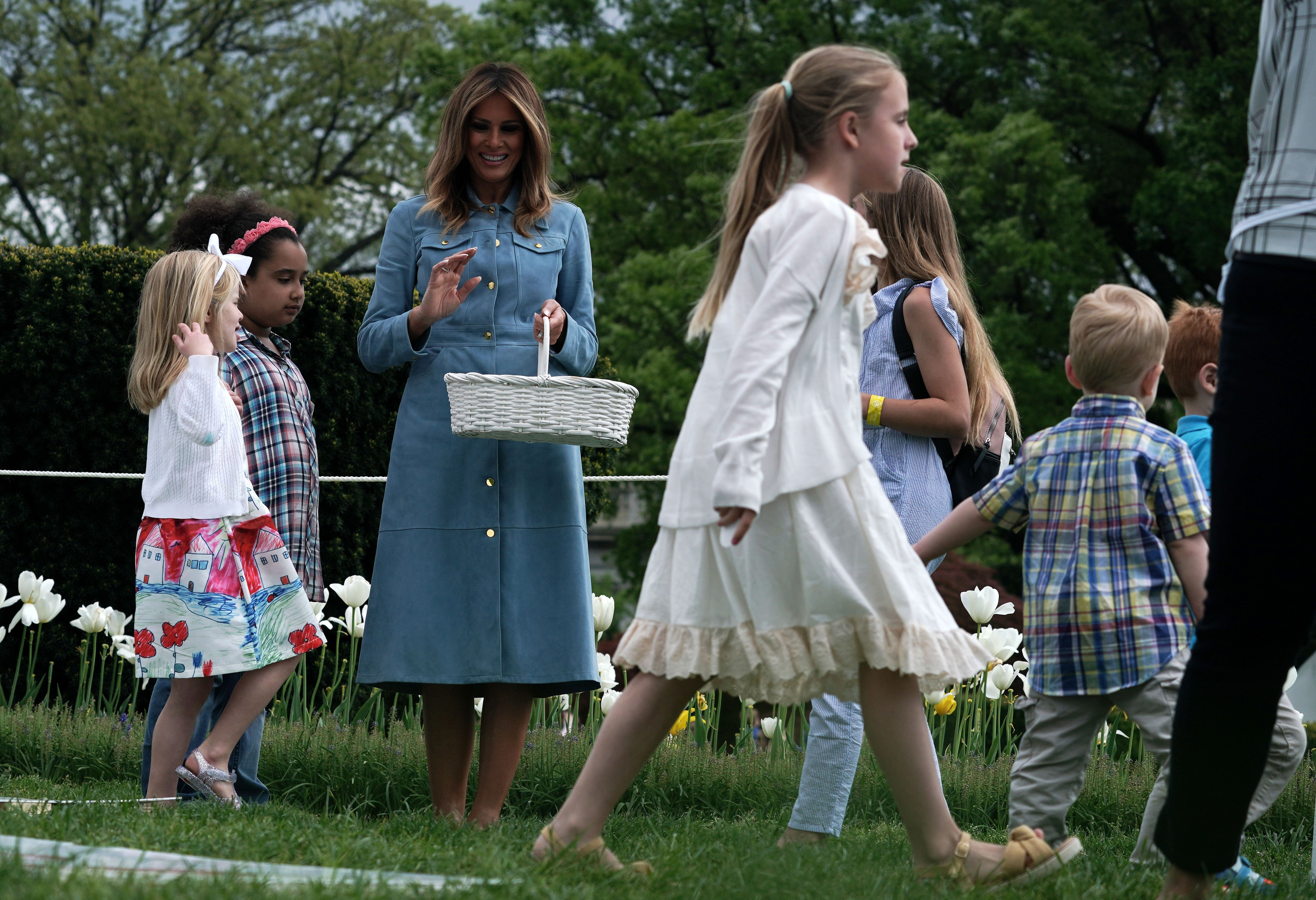Melania Trump watching children participating in the 141st Easter Egg Roll   Photo: Getty Images