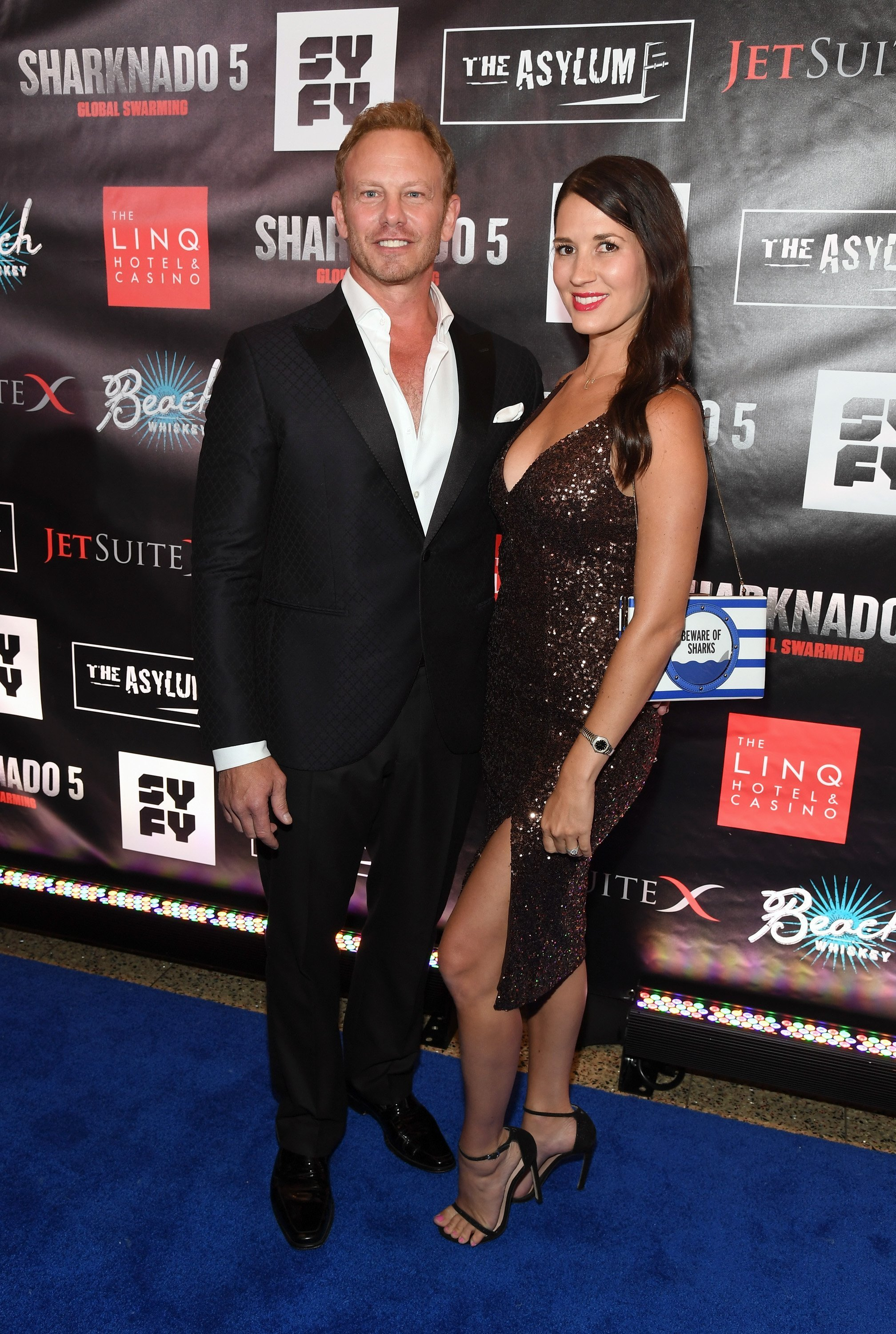 "Ian Ziering (L) and his wife Erin attend the premiere of ""Sharknado 5: Global Swarming""  on August 6, 2017, in Las Vegas, Nevada. 