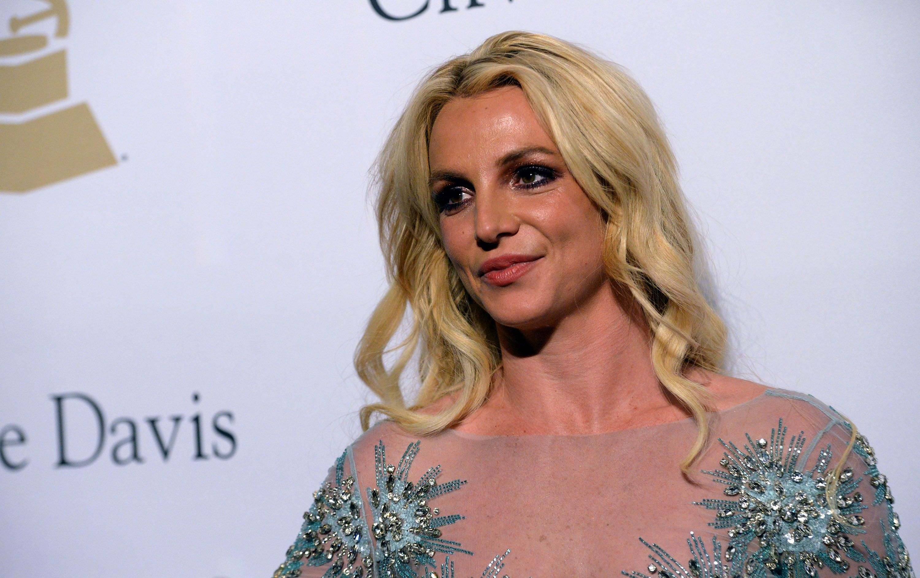 Britney Spears walking down the red carpet at the 2017 Pre-GRAMMY Gala at The Beverly Hilton Hotel in Beverly Hills, California   Photo: Scott Dudelson/Getty Images