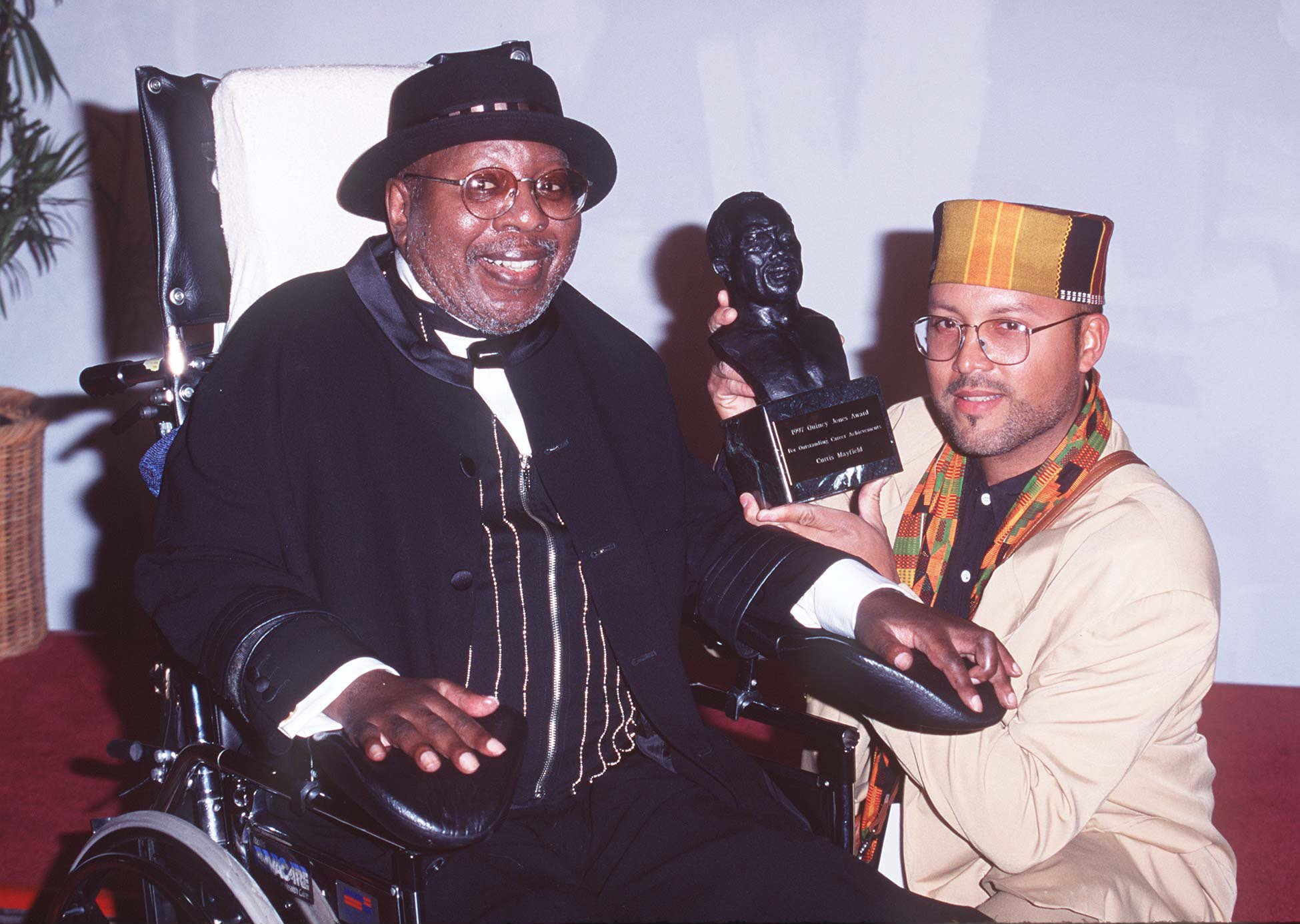 Curtis Mayfield and his son Tracy at the 11th Annual Soul Train Music Awards on March 07, 1997 in Los Angeles, California | Photo: Getty Images