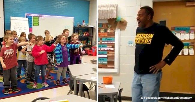 Deaf custodian wipes tears from his eyes as kindergarteners 'sing' 'Happy Birthday' to him (video)