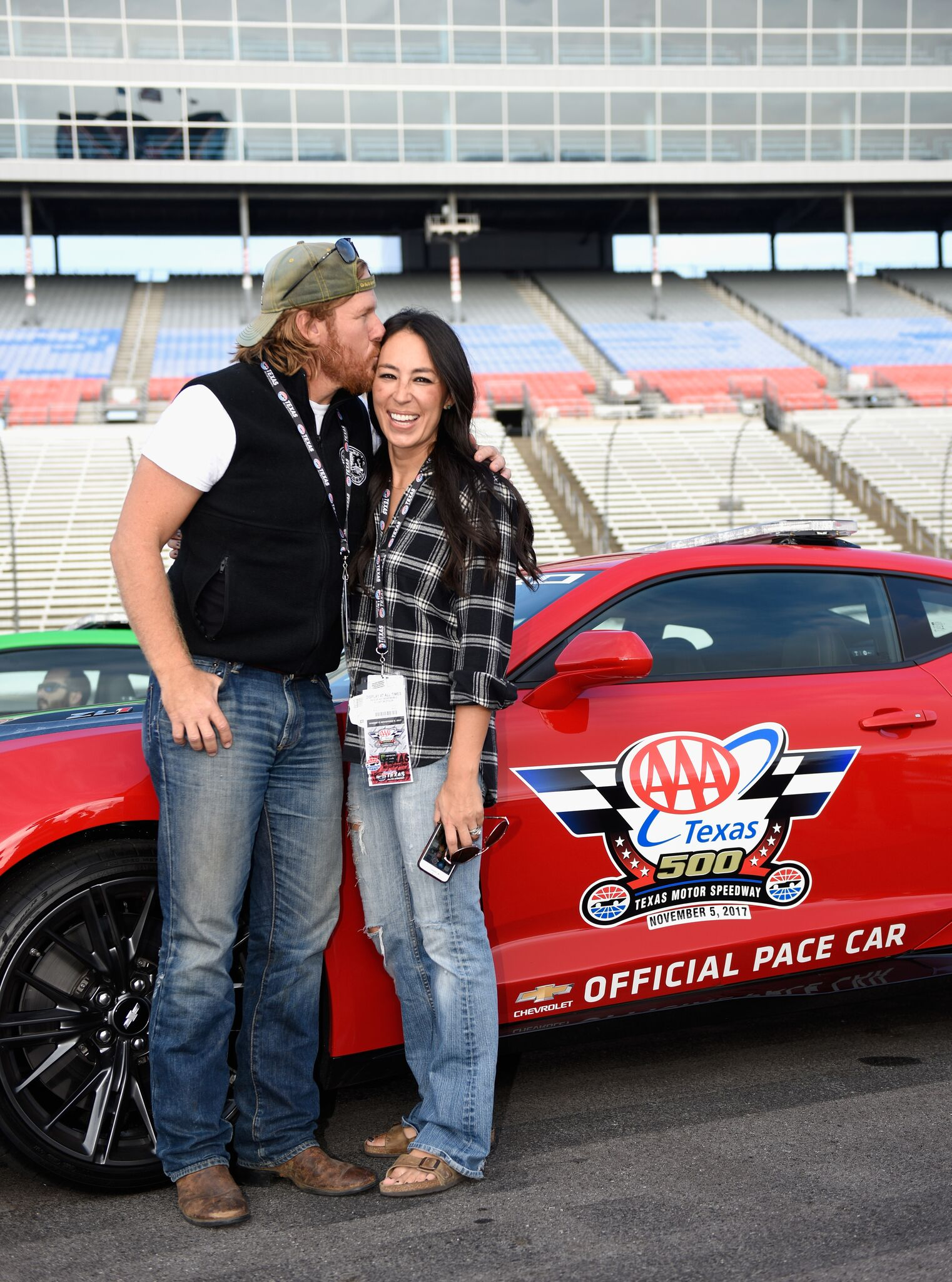 Chip and Joanna Gaines pose with the Monster Energy NASCAR Cup Series AAA Texas 500 pace car | Getty images / Global Images Ukraine