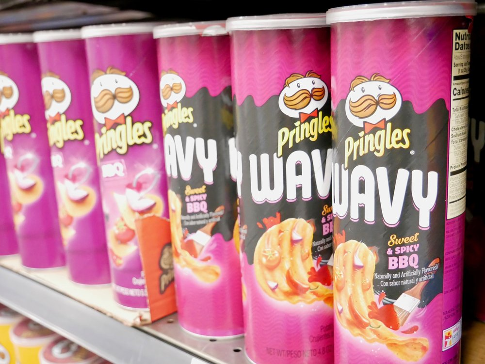 Pringles Wavy Sweet n Spicy BBQ Potato Chips on shelves at local Winco Food Store on November 21, 2020   Photo: Shutterstock