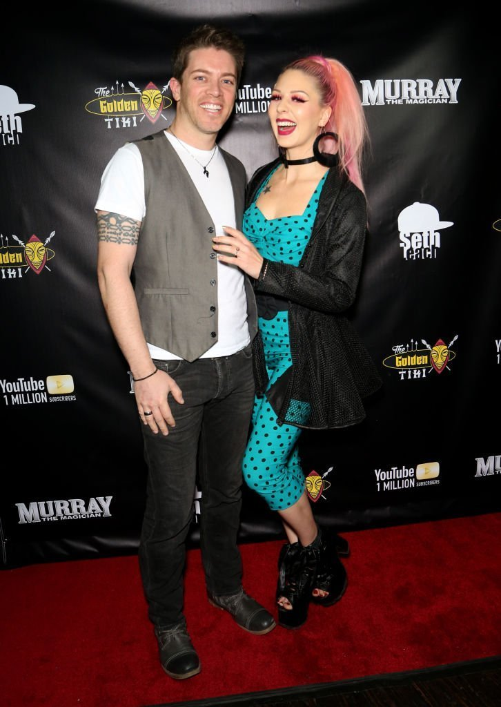 Television personality J.D. Scott (L) and model Annalee Belle attend Murray SawChuck's celebration of 1 Million YouTube subscribers at The Golden Tiki | Photo: Getty Images