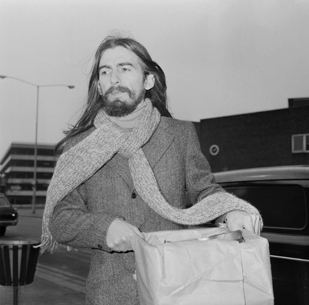 English guitarist, singer and songwriter George Harrison (1943 - 2001) of the Beatles at London Airport | Getty Images / Global Images Ukraine