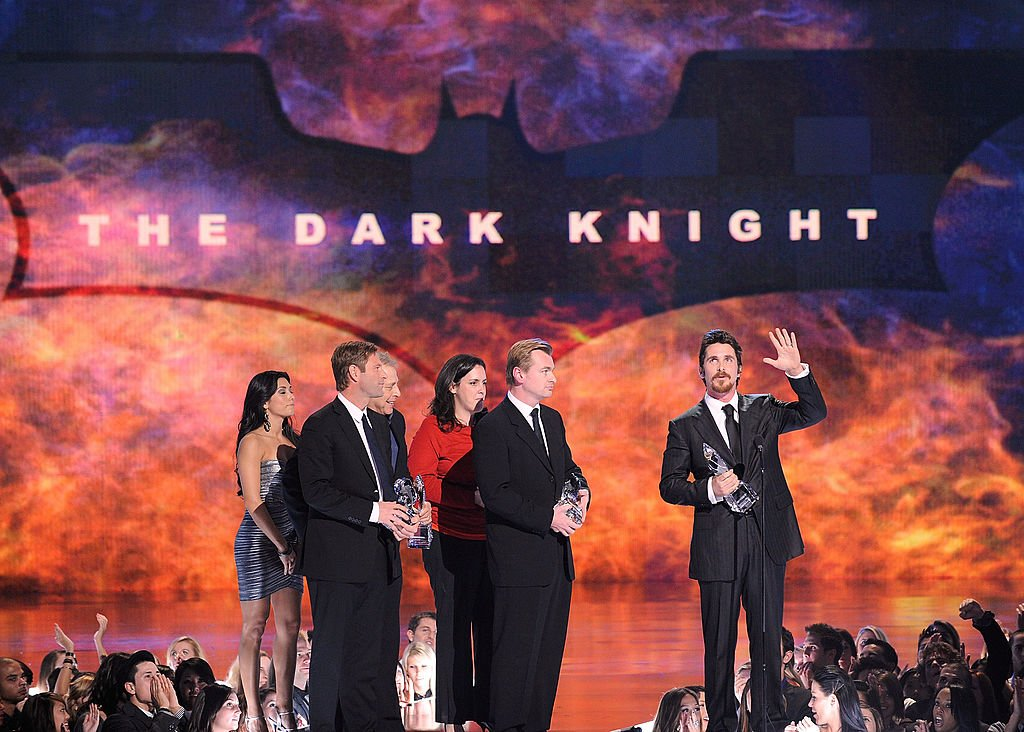 Actor Aaron Eckhart, producers, Director Christopher Nolan and actor Christian Bale accept multiple awards (Favorite On-Screen Match-Up, Action Movie, Cast and Superhero) for The Dark Knight during the 35th Annual People's Choice Awards held at the Shrine Auditorium on January 7, 2009 in Los Angeles, California | Photo: Getty Images