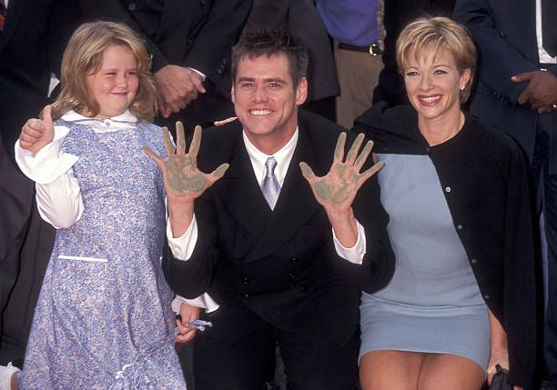 Jim Carrey, Lauren Holly and his daughter Jane Carrey attend Jim Carrey's hand and footprints in cement ceremony. | Source: Getty Images