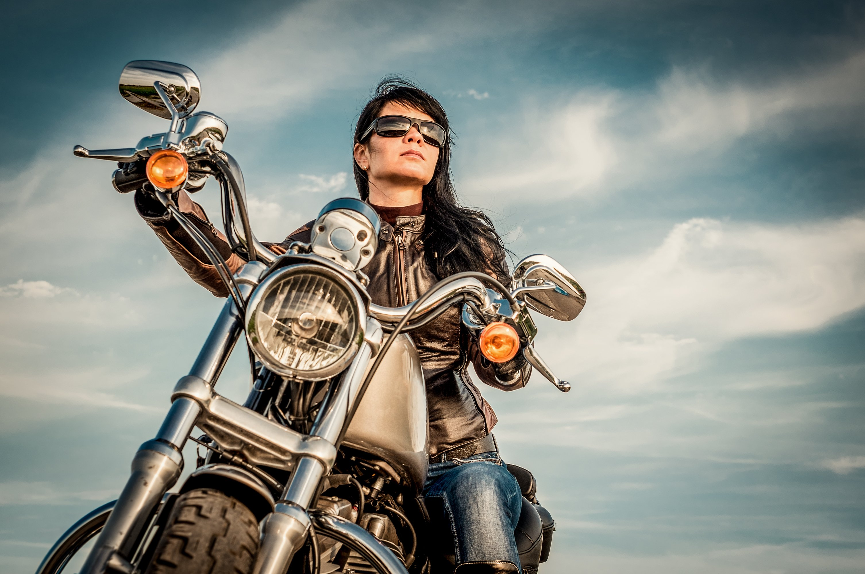 Woman on a motorcycle. Image credit: Shutterstock