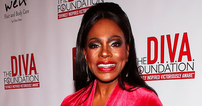 Sheryl Lee Ralph Wears Velour Red Dress and Jewelry While Reading Her Book 'Redefining Diva'