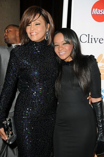 Singer Whitney Houston and Bobbi Kristina Brown arrives at the 2011 Pre-GRAMMY Gala | Photo: Getty Images