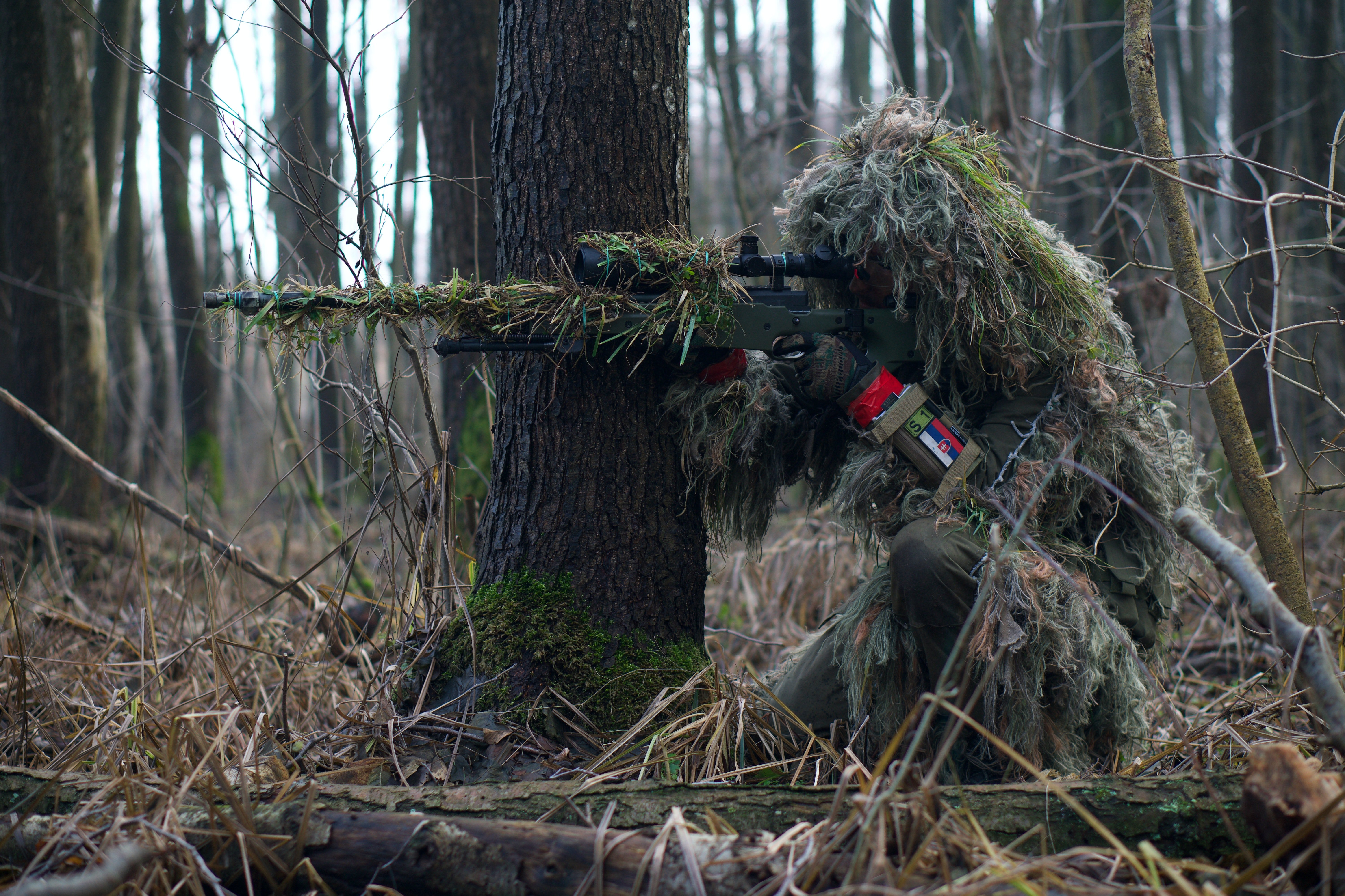 A man on camouflage shooting in the woods.   Pexels/  Kony Xyzx