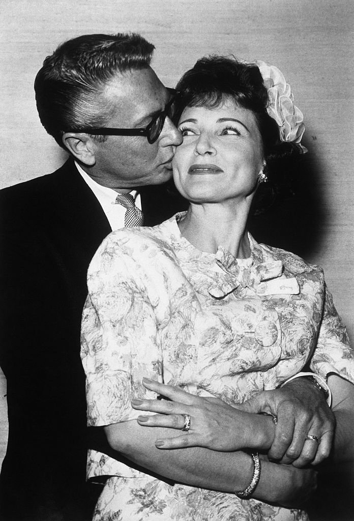 """Allen Ludden, 45, of TV """"Password"""" embraces his bride, actress Betty White, 41, following their wedding at the Sands Hotel in Las Vegas, Nevada circa 1963 