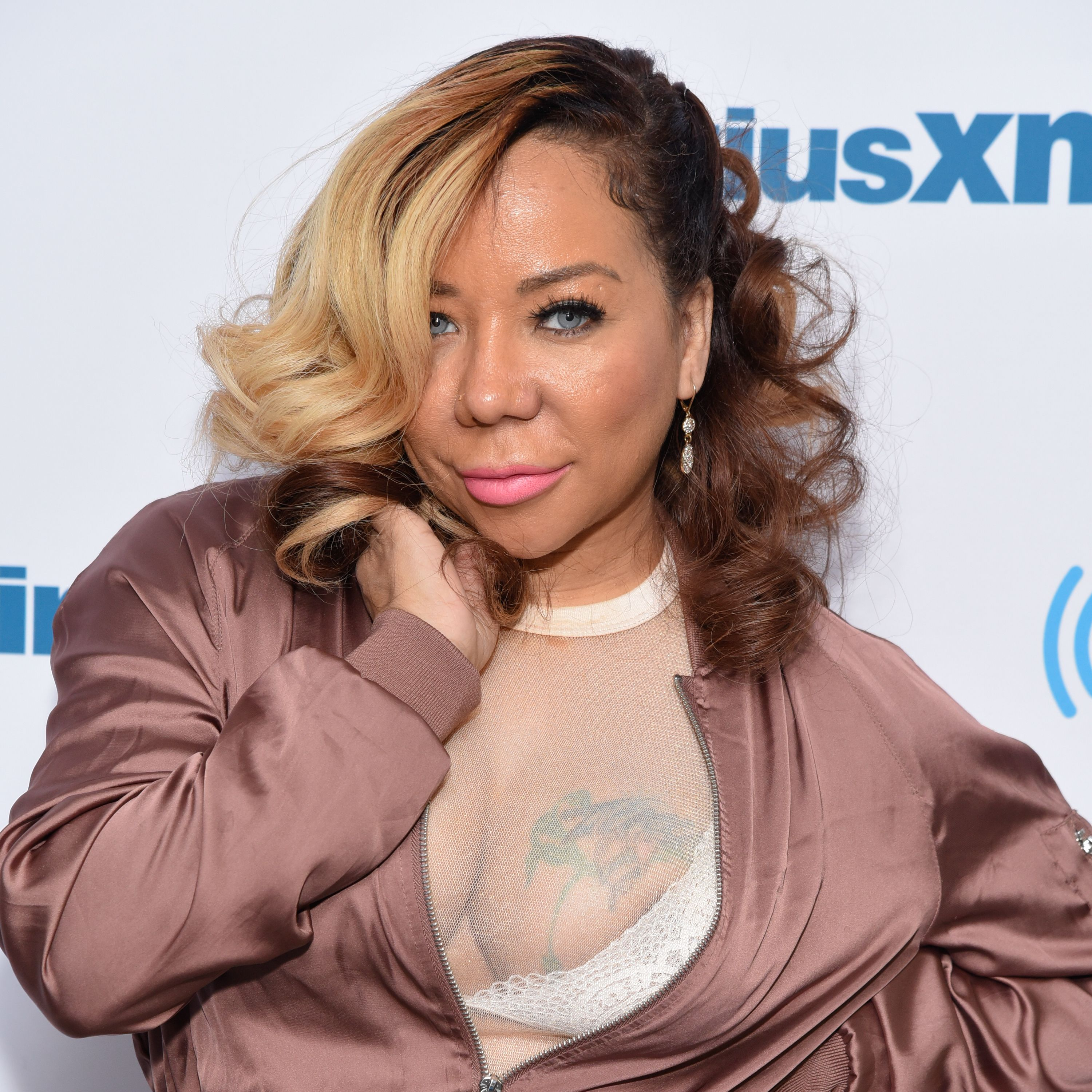 "Reality star Tameka ""Tiny"" Harris visits SiriusXM Studios in New York City in 2017. 