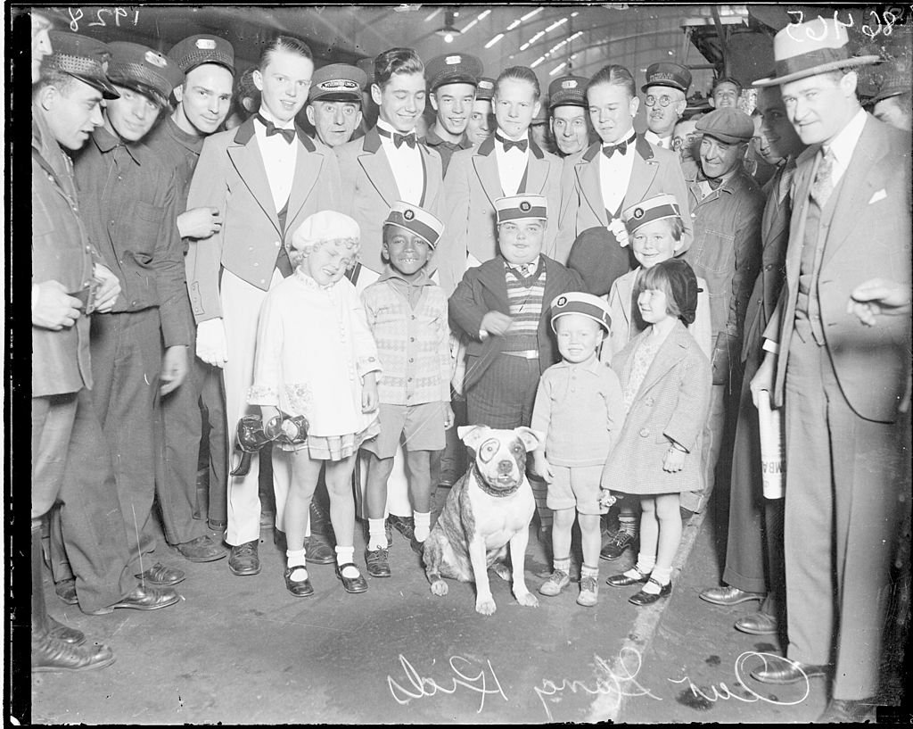 """Group portrait of six child actors from the """"Our Gang"""" comedy series standing in a railroad station in Chicago, Illinois, 1928 