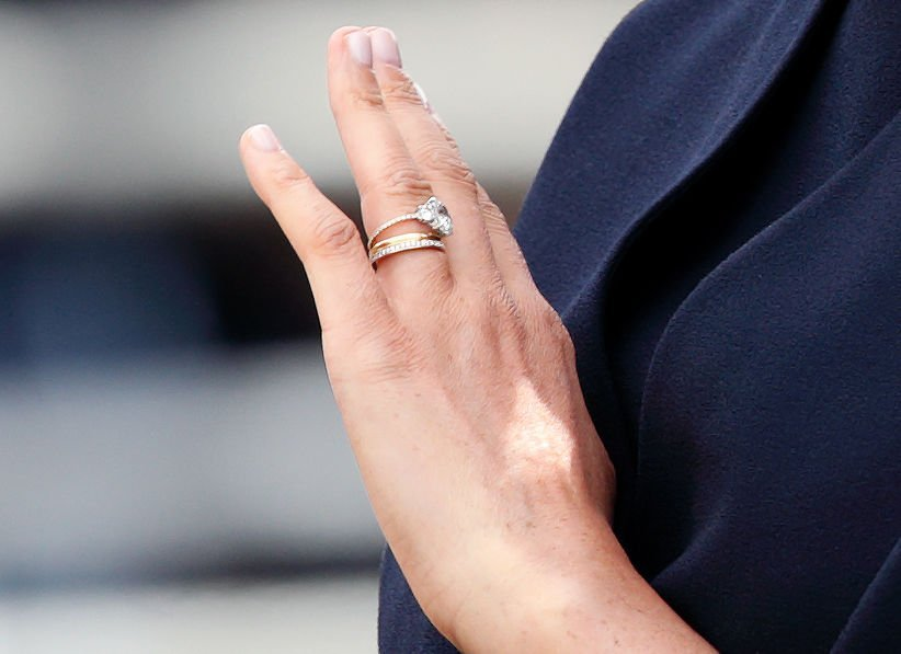 Meghan, Duchess of Sussex (ring detail) as she rides in carriage during Trooping The Colour on June 8, 2019 | Photo: Getty Images