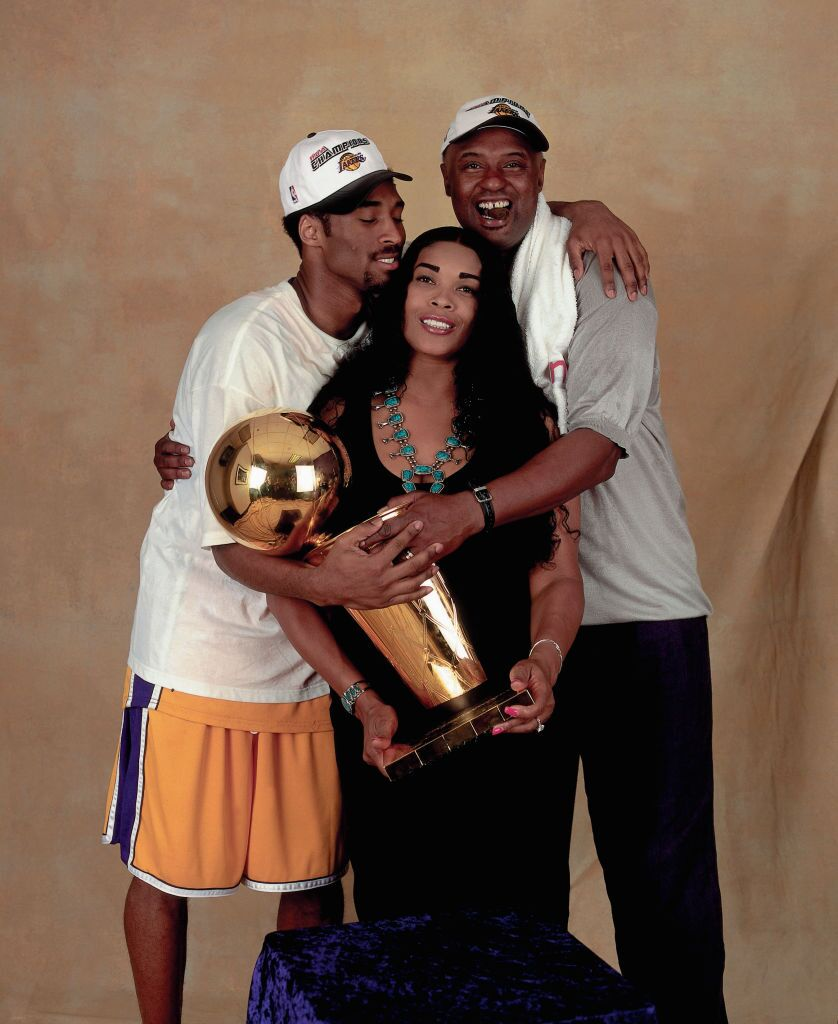 Kobe Bryant and his parents celebrating one of the LA Lakers' championships | Source: Getty Images/GlobalImagesUkraine