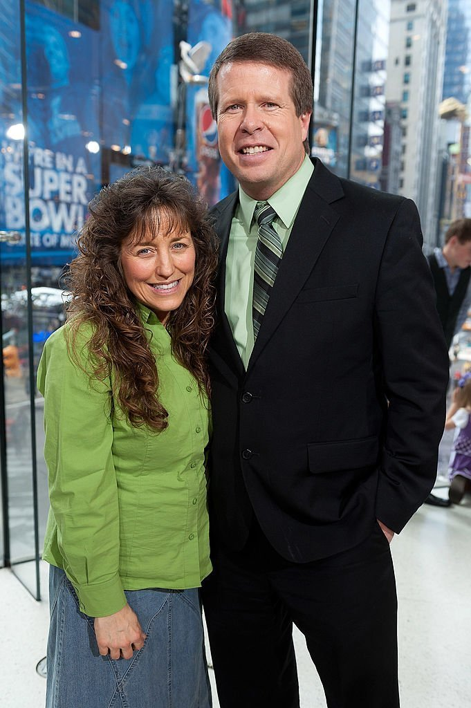 """Jim Bob Duggar (R) and wife Michelle Duggar visit """"Extra"""" at their New York studios at H&M in Times Square 