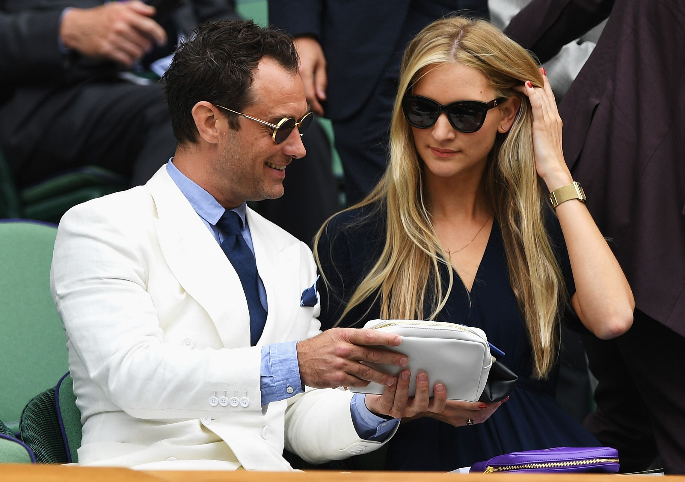 Jude Law and Phillipa Coan watch on as Roger Federer of Switzerland plays Milos Raonic of Canada in the Men's Singles Semi Final match on day eleven of the Wimbledon Lawn Tennis Championships at the All England Lawn Tennis and Croquet Club on July 8, 2016 in London, England. | Photo: Getty Images