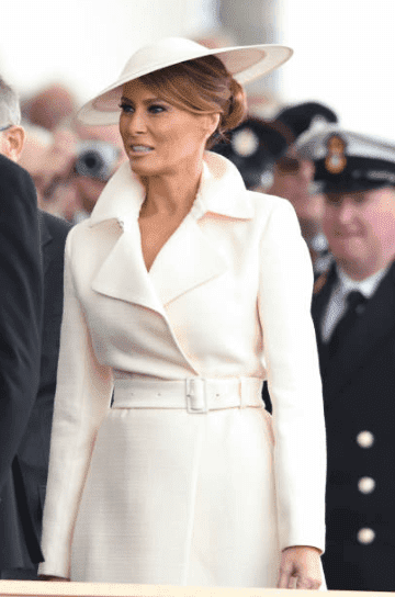 """Melania Trump wears a white coat by """"The Row"""" at the D-Day75 National Commemorative Event, on June 05, 2019, in Portsmouth, England   Source: Getty Images (Photo by Karwai Tang/WireImage)"""
