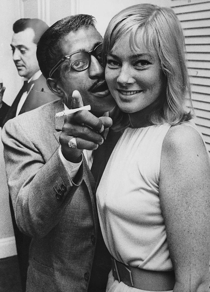American entertainer Sammy Davis Jr. (1925 - 1990) meets his future wife, Swedish actress May Britt, on her arrival at London Airport from Hollywood, 4th June 1960.   Photo: Getty Images