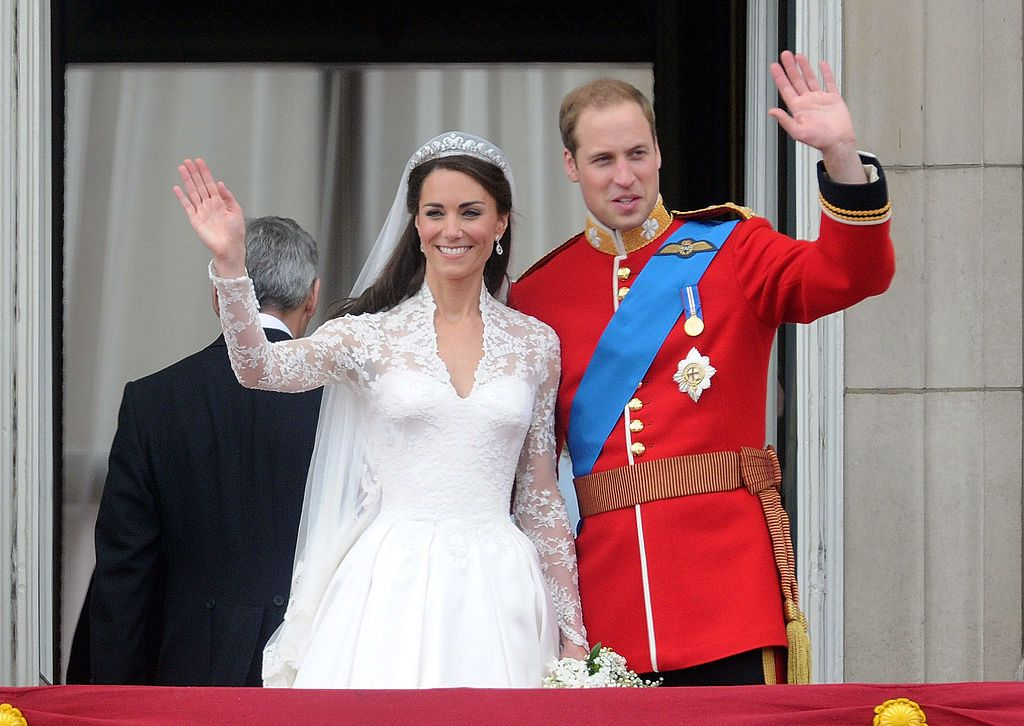Kate Middleton, Duchess of Cambridge and Prince William, Duke of Cambridge, standing on the balcony of Buckingham Palace after getting married in London, England | Photo: Anwar Hussein/WireImage