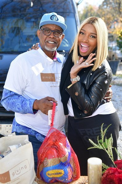 Gregg Leakes and Nene Leakes attend Thanksgiving Meal Giveaway with Nene and Marlo at Gio's on November 19, 2017 | Photo: Getty Images