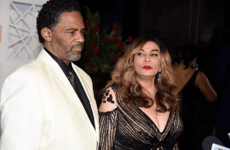 "Tina Knowles stares at Richard Lawson as they arrived at ""The Trifecta Gala"" on May 4, 2018, in Louisville, Kentucky. 