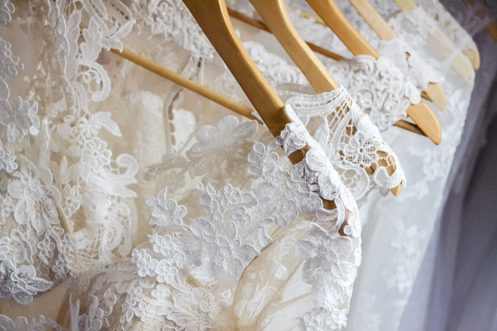 Wedding dresses hanging on a hanger. Fashion look. Interior of bridal salon |Photo: Shutterstock