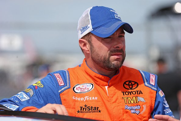 : Eric McClure, driver of the #24 Hefty Toyota, waits for qualifying for the NASCAR XFINITY Owens Corning AttiCat 300 at Chicagoland Speedway on June 20, 2015 | Photo: Getty Images