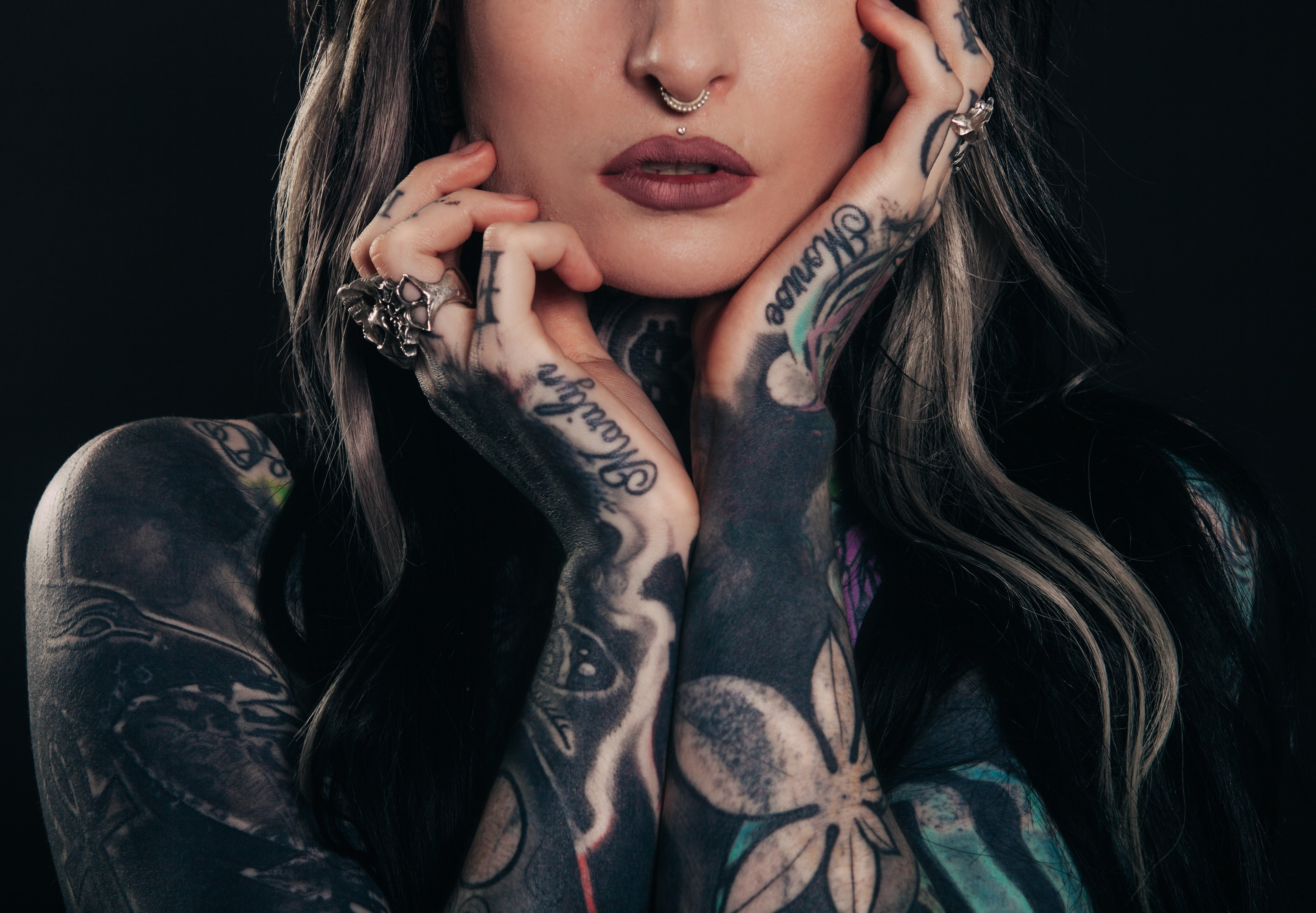 A girl with tattoos   Source: Unsplash.com