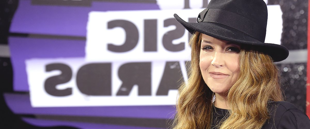 Lisa Marie Presley Shares Sweet Photo with Her Twin Daughters and Their Foster Puppy
