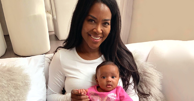 RHOA Star Kenya Moore Melts Hearts with Photo of Smiling Baby Brooklyn Standing at 9 Months Old