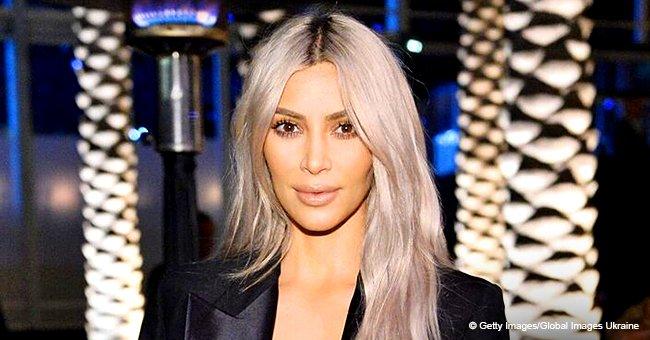 Kim Kardashian turns up the heat in bust-baring dress with thigh-high slit, risking a nip slip