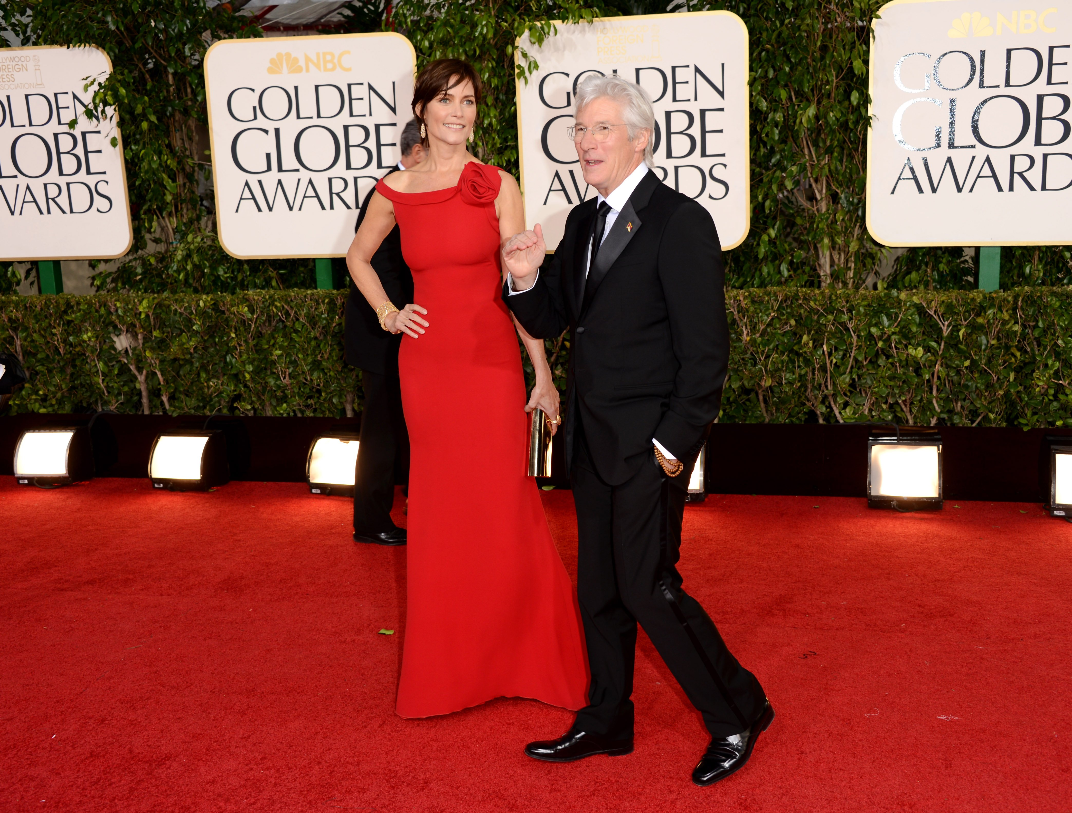 Carey Lowell (L) and actor Richard Gere arrive at the 70th Annual Golden Globe Awards held at The Beverly Hilton Hotel on January 13, 2013, in Beverly Hills, California. | Source: Getty Images.