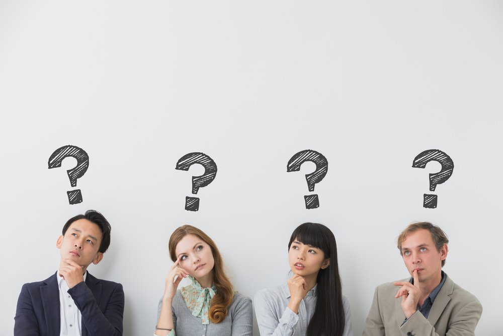A photo that shows four people thinking | Photo: Shutterstock