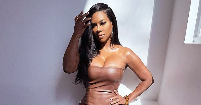 RHOA's Kenya Moore Looks Unforgettable Showing Slim Figure in a Tight off-Shoulder Beige Dress