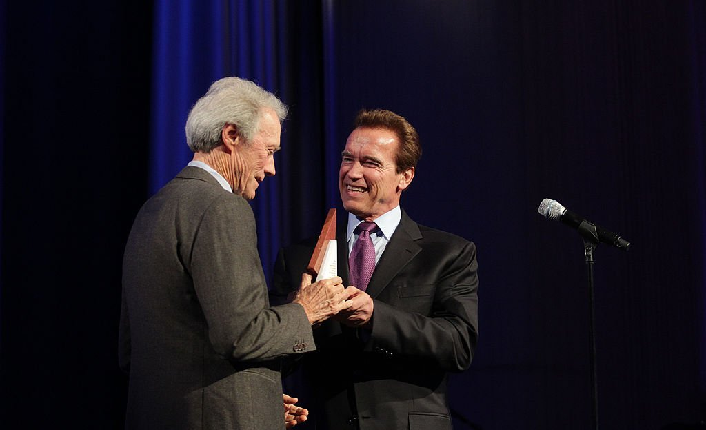 Clint Eastwood (L) accepts his award from Arnold Schwarzenegger, Governor of California during the Museum of Tolerance International Film Festival Gala. | Photo: Getty Images