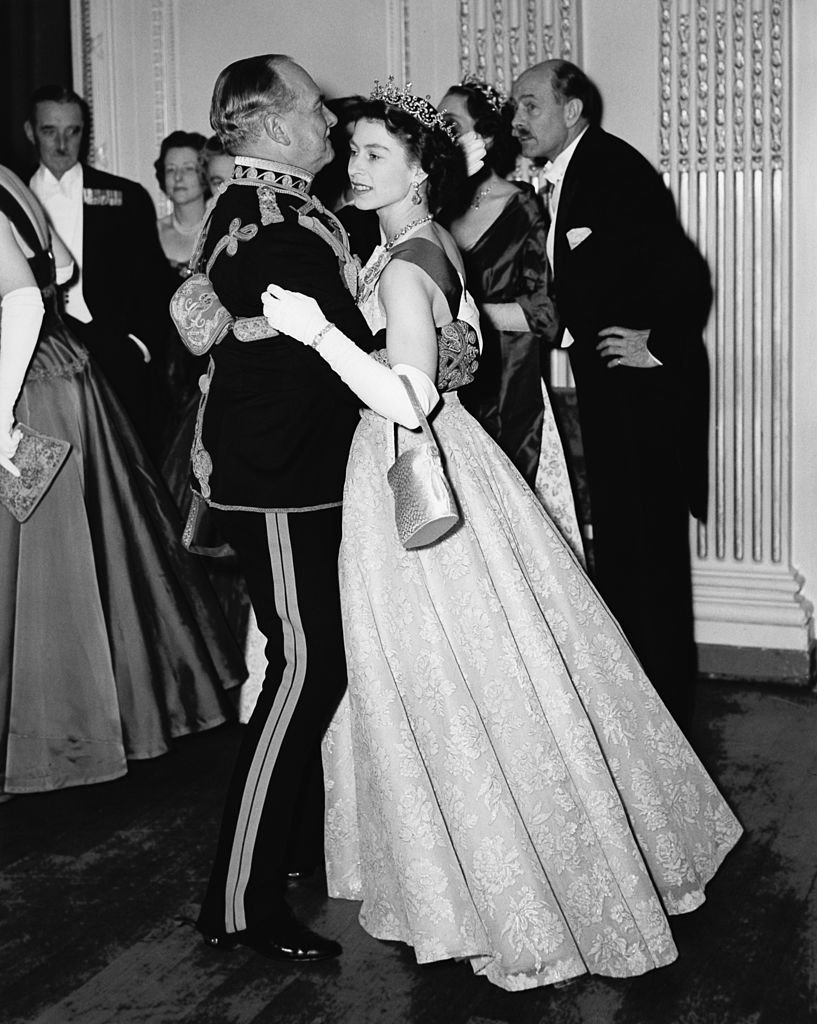 Queen Elizabeth II dancing with Air Marshal Sir John Baldwin (1892 - 1975), colonel of the 8th Hussars, at a ball held at the Hyde Park Hotel, London,  November 26, 1954. The ball celebrates the centenary of the Battle of Balaclava. | Source: Getty Images.