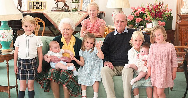 Prince Philip and the Queen Seen Cuddling 7 Great-Grandchildren in Previously Unreleased Photograph
