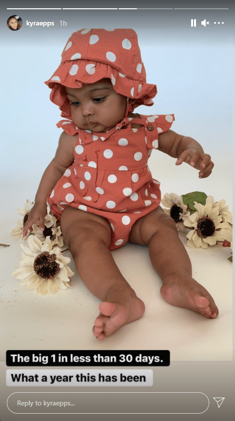 Baby Indiana Rose Epps poses for a photo in polka-dot outfit. │ Source: Instagram/kyraepps