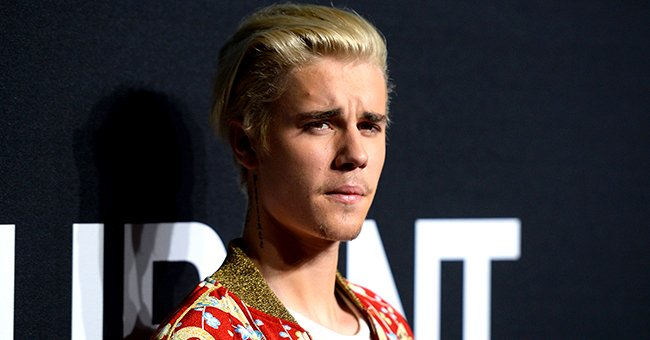 See the Large Neck Tattoo Justin Bieber Debuted Courtesy of His Trusted Artist Dr Woo