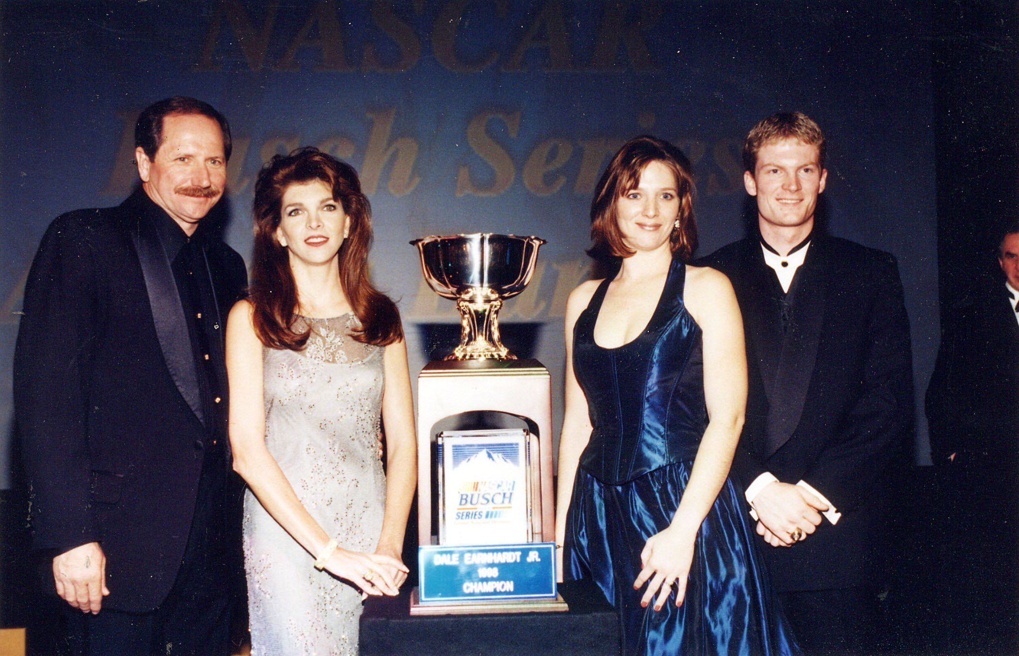 Dale Earnhardt Sr., with wife Teresa, daughter Kelley and son Dale Earnhardt Jr., who received the NASCAR Busch Series Championship Cup in 1998 in New York | Source: Getty Images