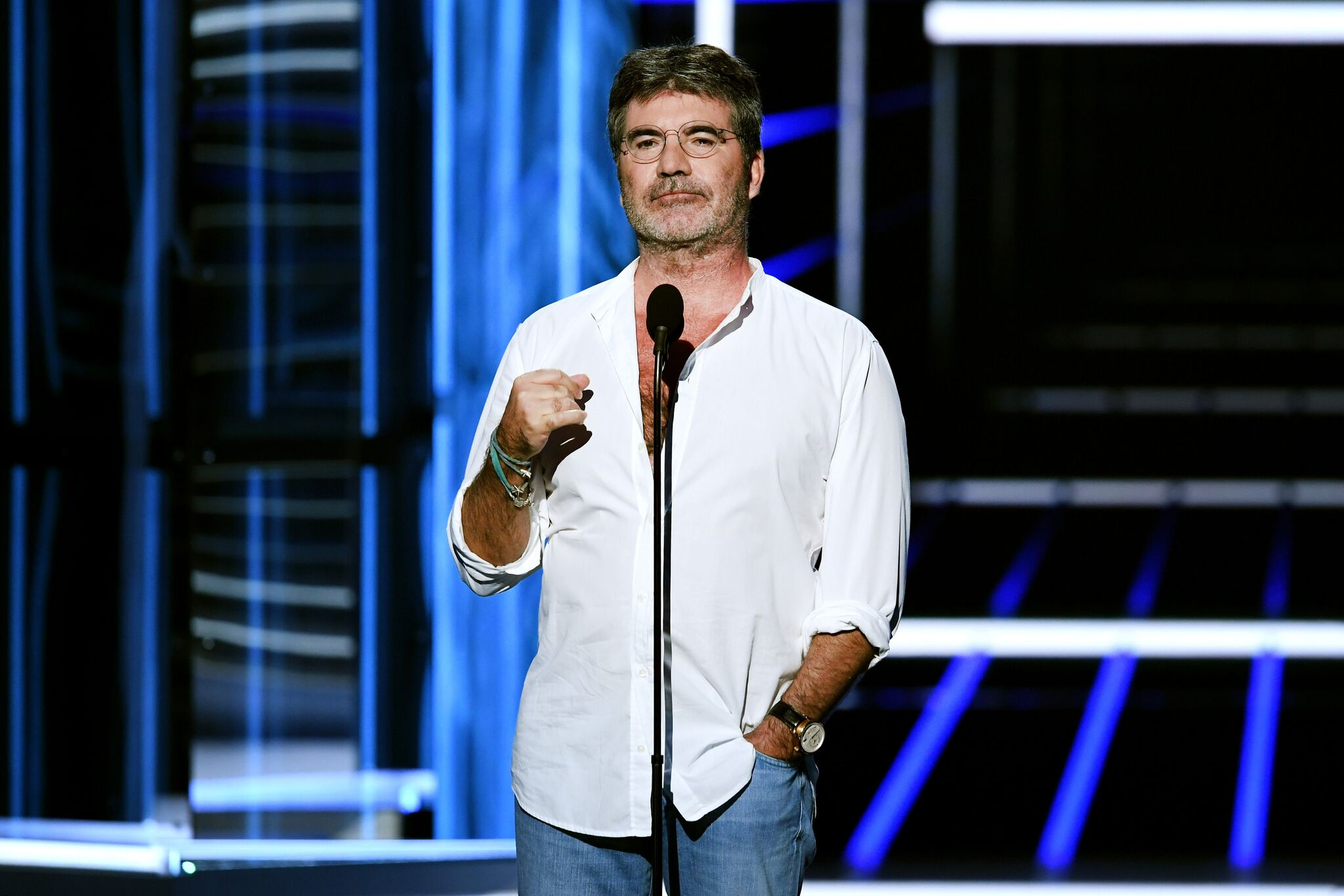 Simon Cowell speaks onstage during the 2018 Billboard Music Awards | Getty Images