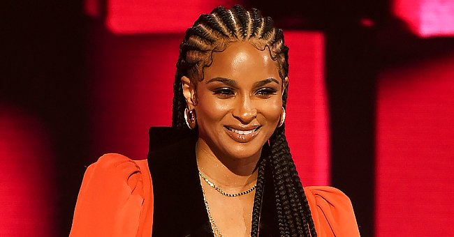 Ciara Shows Plenty of Cleavage & Her Long Dreads Posing in New Photos in a Tight Black Jumpsuit