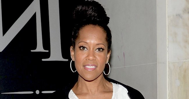 'Watchmen' Star Regina King Stuns in a Gown by Versace with Dark Blue Sequins & Ruffled Sleeves