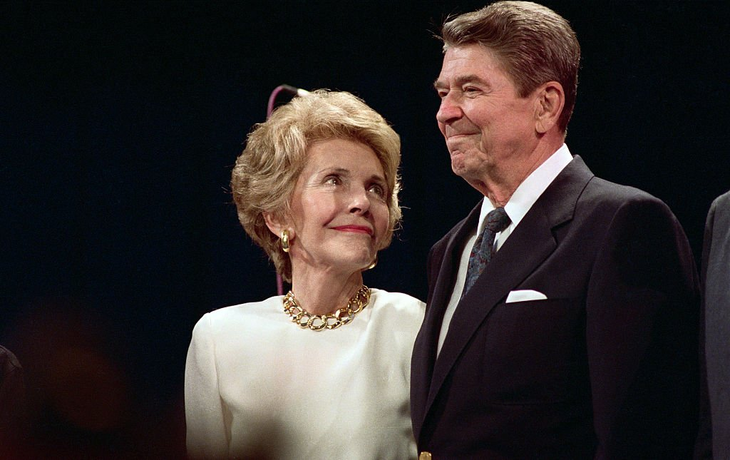 Nancy Reagan looks up at her husband, President Reagan, with loving eyes as he makes a surprise visit to a party in Nancy's honor here 8/15, in New Orleans, 1988. | Source: Getty Images